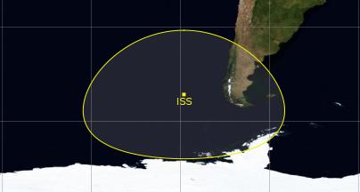 Image montrant l'ISS au large de l'Amérique du Sud entourée par la zone de visibilité terrestre.