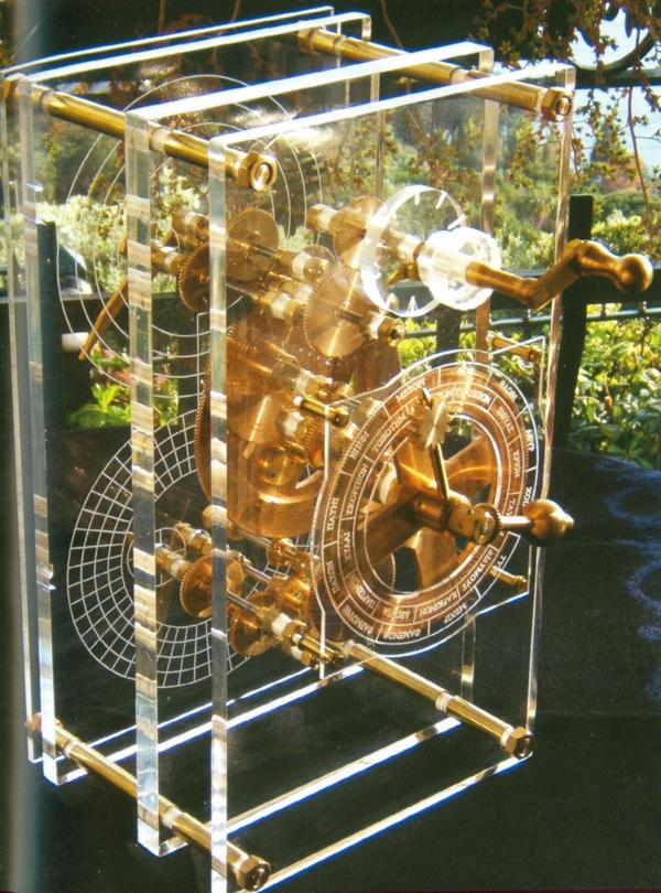 """Reconstitution de la machine d'Anticythère. Extrait de la page 25 de """"Histoire Illustrée de l'informatique"""""""